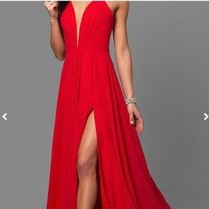 Red Faviana prom dress with a slit in the side